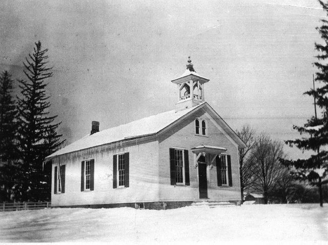 Boughton Hill School black and white photo of one story wooden structure with steeple for bell