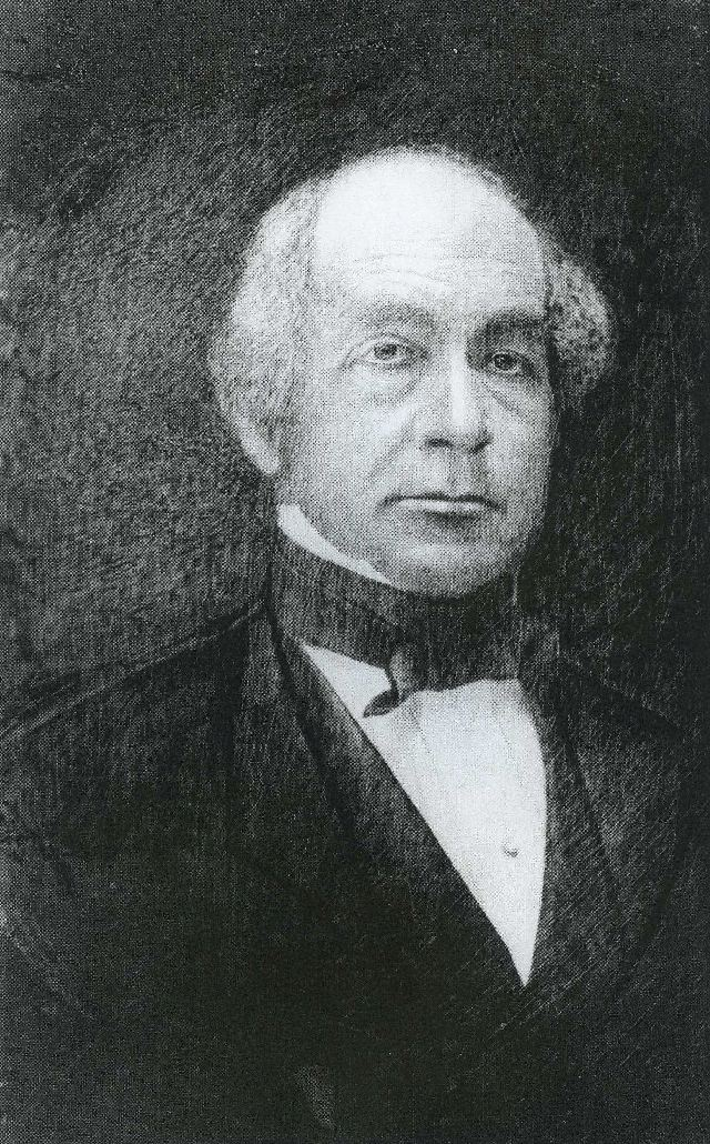 black and white photo of Henry Pardee shoulders up in black suit